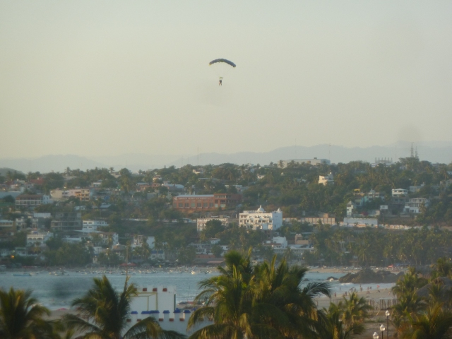 skydivers land on the beach each evening at sunset