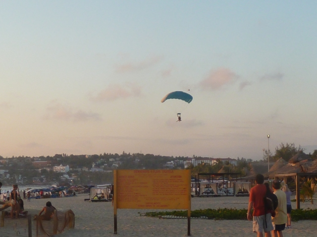 skydivers land on the beach every evening at sunset