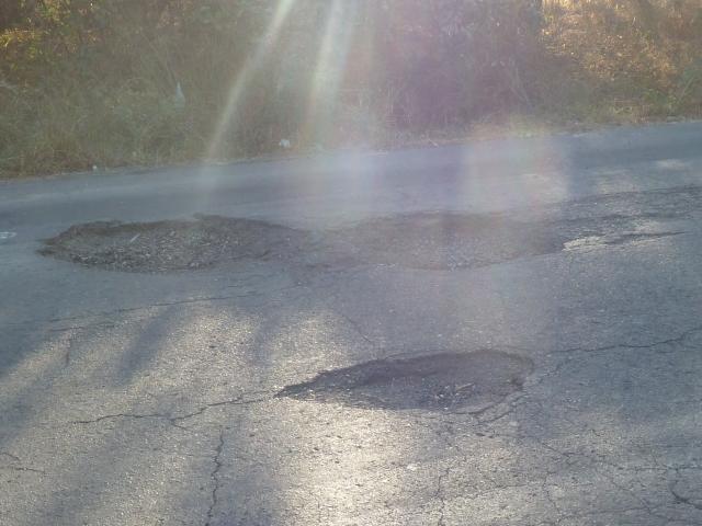 Honduras - potholes are like craters!
