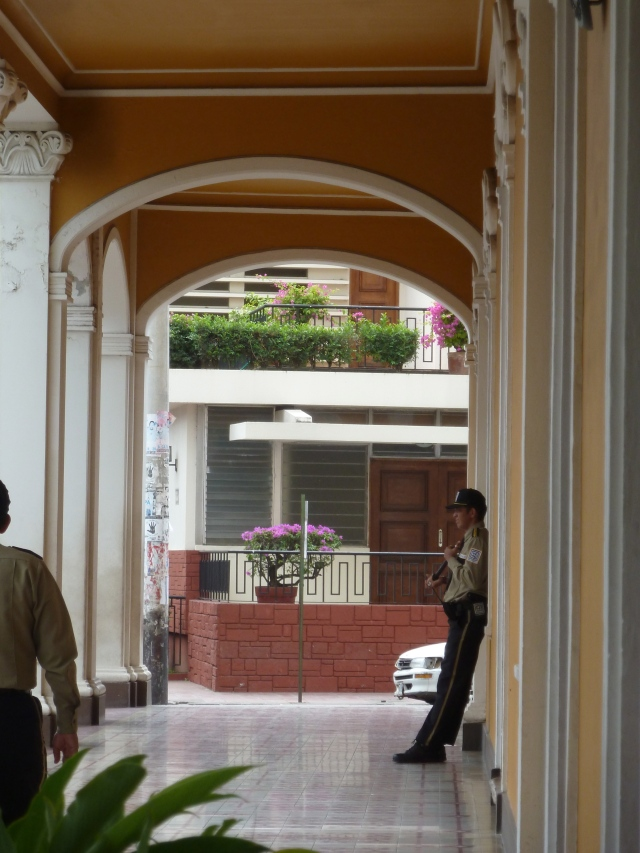 Colonial architecture and a guard in Granada, Nicaragua