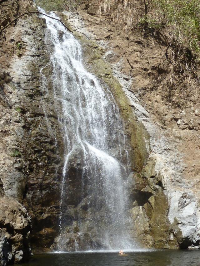Swimming under the waterfall - Montezuma, Costa Rica