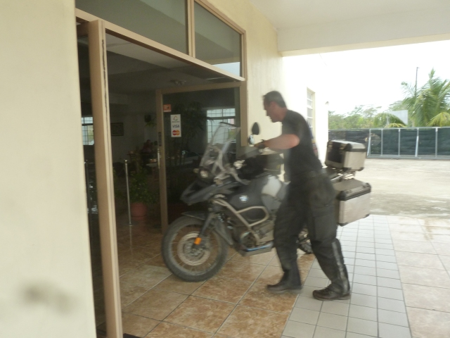 Parking the bike in the hotel lobby, Belize City, Belize